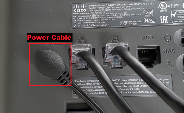 shows the power cable plugged into the back of the cisco phone labeled as Power Cable